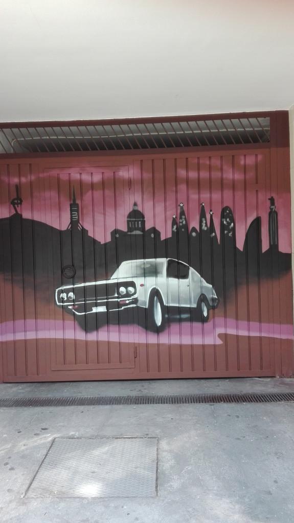 mural en puerta metálica de parking . graffiti artístico