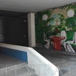 Mural en pared parking calle Tavern Sant Gervasi Barcelona hecho por ArteExtra