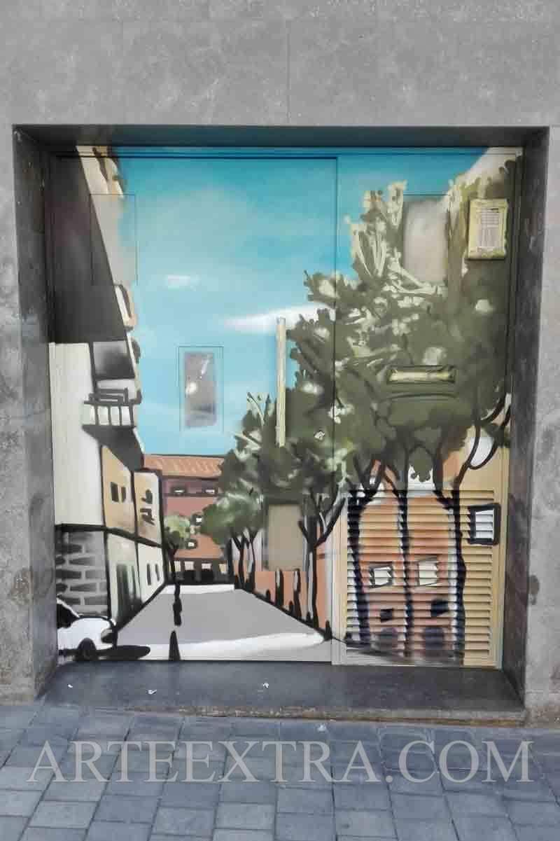 Mural en puerta metálica Lesseps Barcelona - ArteExtra