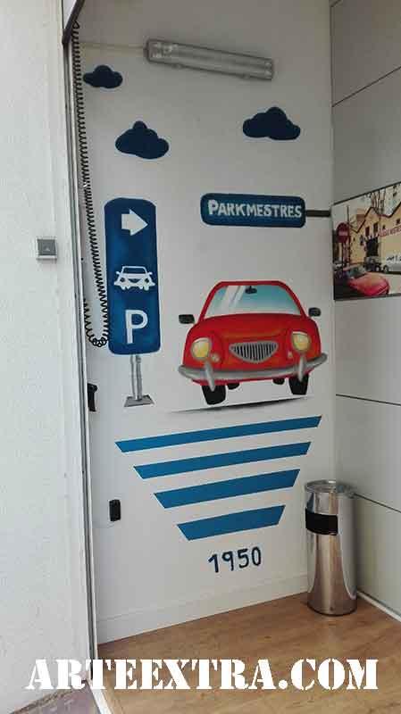 Mural interior entrada con graffiti  señaléctica parking en Barcelona - ArteExtra