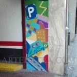Paredes entrada parking decoradas graffiti en Eixample Barcelona ArteExtra