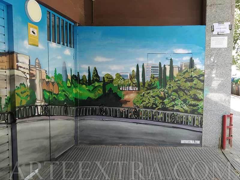 Mural graffiti en pared entrada parking en calle Ali-Bei Barcelona - ArteExtra