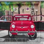 Decoración graffiti 600 en puerta parking metálica Guinardó ArteExtra coche