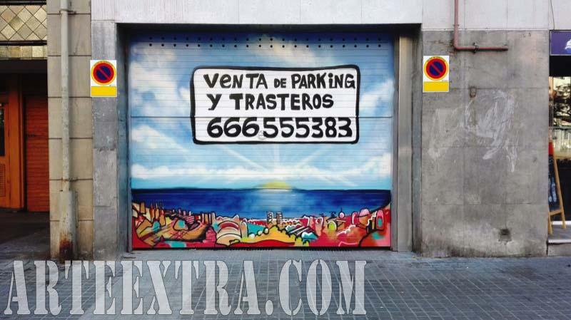 Persiana metálica parking decorada con graffiti skyline Barcelona en calle Marina - Arte Extra 2017