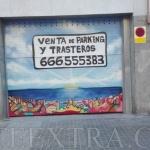 Puerta metálica parking decorada con graffiti skyline de Barcelona - ArteExtra