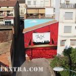 Plano general pintura mural en graffiti de platea cine Oliana Lleida - Pintado por ArteExtra en 2018 - 2