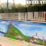 Mural graffiti en patio colegio de Barcelona - ArteExtra