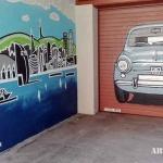 Puerta metálica y pared lateral parking decorada con 600 en espray graffiti Eixample Barcelona - ArteExtra