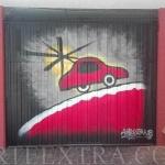 Decoración puerta parking en graffiti inspiración Miró   realizado por ArteExtra