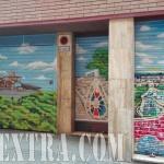 Parking decorado graffiti con paisaje cripta de Gaudí en Barcelona - ArteExtra