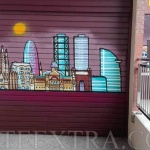 Decoración skyline en puerta metálica parking Barcelona - ArteExtra