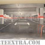 Decoración trampantojo de entrada puertas abiertas parking en Barcelona - ArteExtra